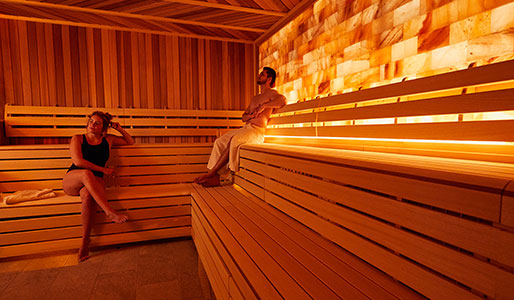 Man and lady sat in the sauna at David Lloyd Royal Berkshire